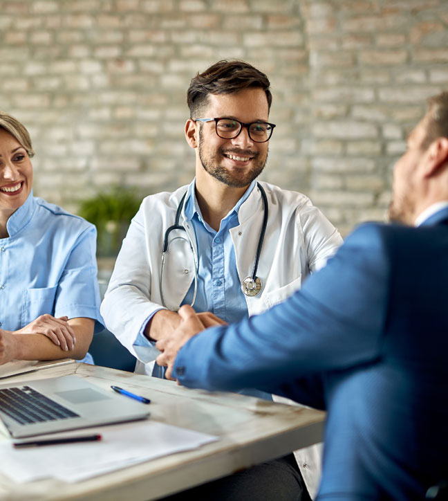 doctor shaking hands with ChartPerfect EHR employee